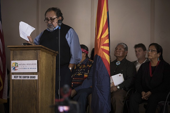 In this photo provided by the Grand Canyon Trust, Arizona Congressman Raul Grijalva announces the Grand Canyon Centennial Protection Act flanked by tribal leaders, county and city officials, and other supporters, including Richard Powskey, back third right, of the Hualapai Tribal Council, and Carletta Tilousi of the Havasupai Tribal Council, right, Saturday, Feb. 23, 2019, in Grand Canyon National Park, Ariz. Grijalva is pushing to make a temporary ban on the filing of new mining claims in the Grand Canyon region permanent. (Amy S. Martin/Grand Canyon Trust via AP)
