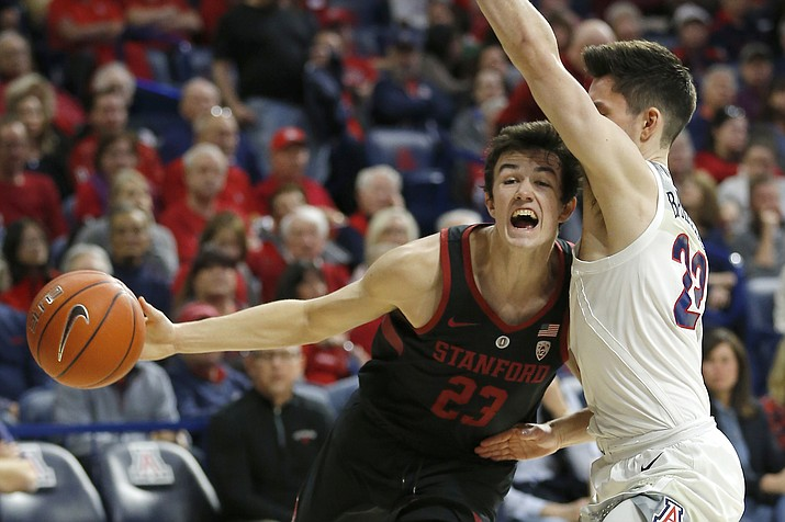 Stanford guard Cormac Ryan (23) drives on Arizona guard Alex Barcello in the first half during an NCAA college basketball game, Sunday, Feb. 24, 2019, in Tucson. (Rick Scuteri/AP)