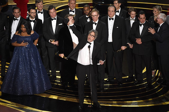 "Peter Farrelly, center, and the cast and crew of ""Green Book"" accept the award for best picture at the Oscars on Sunday, Feb. 24, 2019, at the Dolby Theatre in Los Angeles. (Photo by Chris Pizzello/Invision/AP"