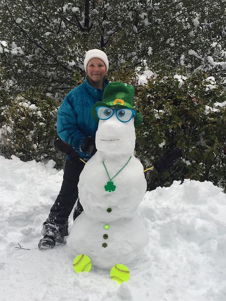 Chloe with Louie the snowman, the newest member of the 2019 Pv clovers softball team