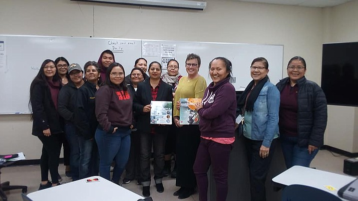 Diné College students and Diné College microbiology instructor Dr. Shazia Tabassum Hakim (middle) from Tuba City pose for a photo at the recent lecture on academic achievement. The lecture was given by Dr. Kelly Cowan (right of Hakim) of Miami University in Ohio.  (Photo/Diné College)