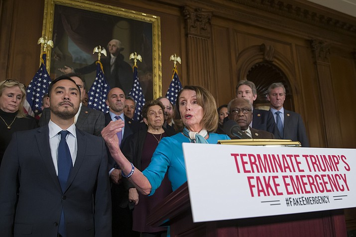 House Speaker Nancy Pelosi of Calif., accompanied by Rep. Joaquin Castro, D-Texas, left, and others, speaks about a resolution to block President Donald Trump's emergency border security declaration on Capitol Hill, Monday, Feb. 25, 2019 in Washington.  (AP Photo/Alex Brandon)