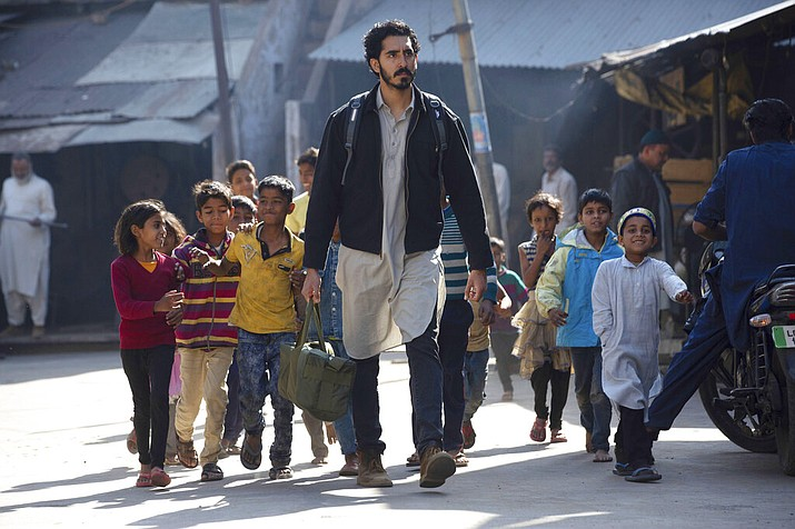 """This image released by IFC Films shows Dev Patel in a scene from """"The Wedding Guest."""" (Ganesh Patil/IFC Films via AP)"""