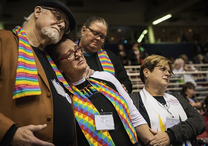 Ed Rowe, left, Rebecca Wilson, Robin Hager and Jill Zundel, react to the defeat of a proposal that would allow LGBT clergy and same-sex marriage within the United Methodist Church at the denomination's 2019 Special Session of the General Conference in St. Louis, Mo., Tuesday, Feb. 26, 2019. America's second-largest Protestant denomination faces a likely fracture as delegates at the crucial meeting move to strengthen bans on same-sex marriage and ordination of LGBT clergy. (Sid Hastings/AP)