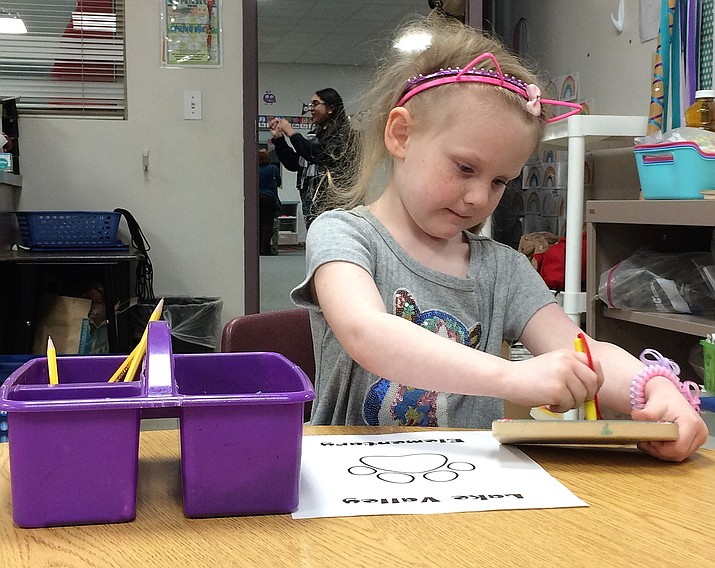 Sammy Rowling, 5, traces the letter N, an easy task for this youngster who is not yet a kindergarten student at Lake Valley Elementary School's open house Feb. 25 when parents and children could visit and register for the 2019-2020 school year. (Sue Tone/Tribune)