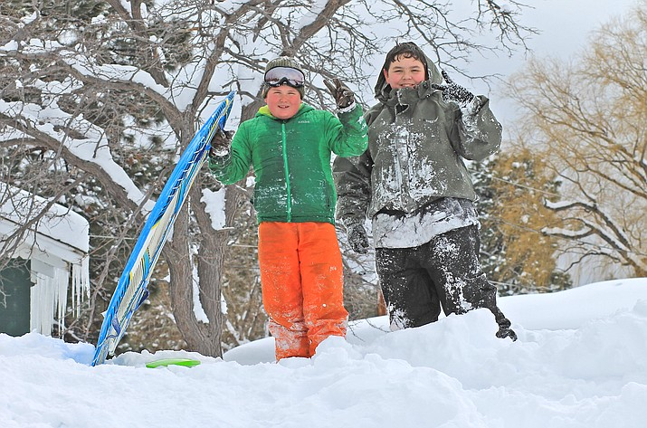 Spunky Pitts and Ethan Michelena take advantage of the massive snow that fell in Williams Feb. 21. The storm caused numerous road closures and many businesses and schools shuttered early in anticipation of the snow. (Wendy Howell/WGCN)