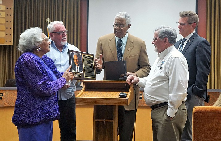 Lula Cooper, left, accepts the plaque that will be displayed in the lobby of Prescott City Hall, honoring Dick Cooper, her husband of 61 years. The presentation was made on Feb. 26 by, from left: City Councilman Steve Blair; Arizona Commission of African American Affairs President Mel Hannah; Yavapai County Supervisor and former Prescott Mayor Rowle Simmons; and current Prescott Mayor Greg Mengarelli. (Cindy Barks/Courier)