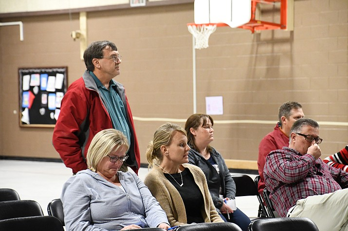 Lee Williams teacher, Ron Bahre, addressed the board Tuesday how students living near White Cliffs Middle School will have to be bused about 4 miles to Kingman Middle School. (Photo by Vanessa Espinoza/Daily Miner)
