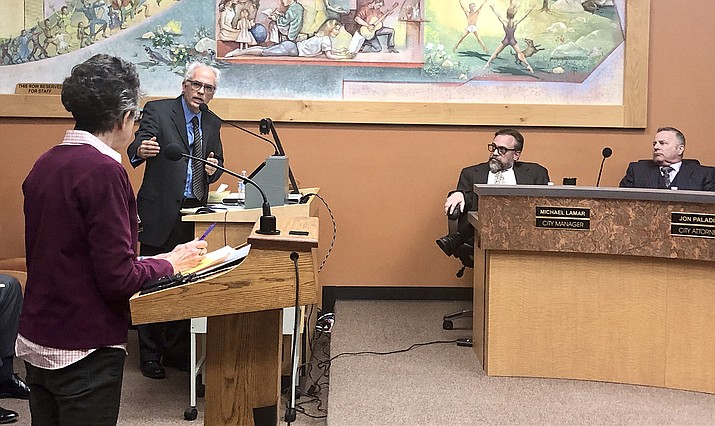 Water expert Gary Woodard, second from left, answers a question from local water advocate Leslie Hoy, left, about the future of water conservation in the community, while Prescott City Manager Michael Lamar and City Attorney Jon Paladini, right, look on Feb. 26, 2019. (Cindy Barks/Courier, file)