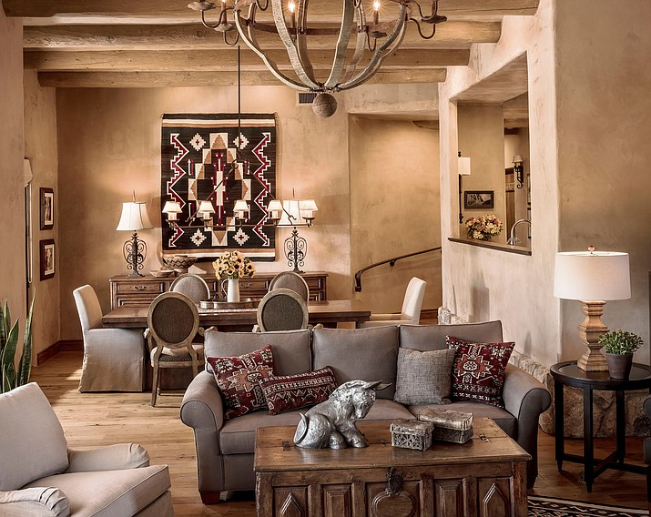The living/dining room in a contemporary Santa Fe home in a beautiful equestrian area in the foothills of the mountains in Tucson. (Steven Meckler/Linda Robinson Design Associates LLC via AP)