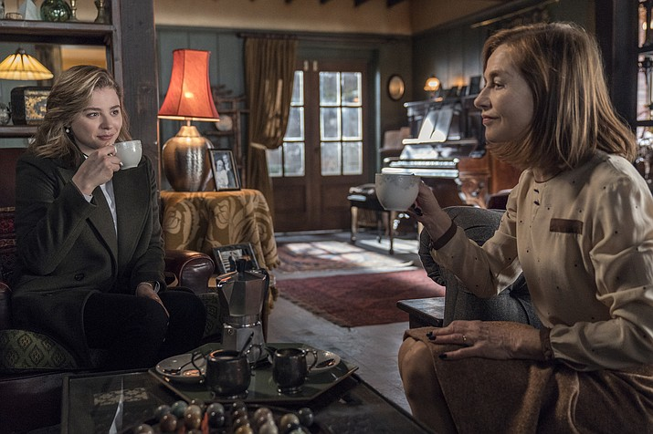 "This image released by Focus Features shows Chloë Grace Moretz, left, and Isabelle Huppert in a scene from ""Greta."" (Jonathan Hession/Focus Features via AP)"