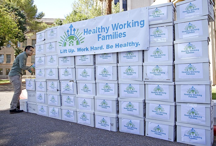 Boxes containing more than 270,000 signatures gathered by the Arizona Healthy Working Families Initiative group sit on display prior to a news conference at the Arizona Capitol, Thursday, July 7, 2016, in Phoenix. (Ross D. Franklin/AP, file)