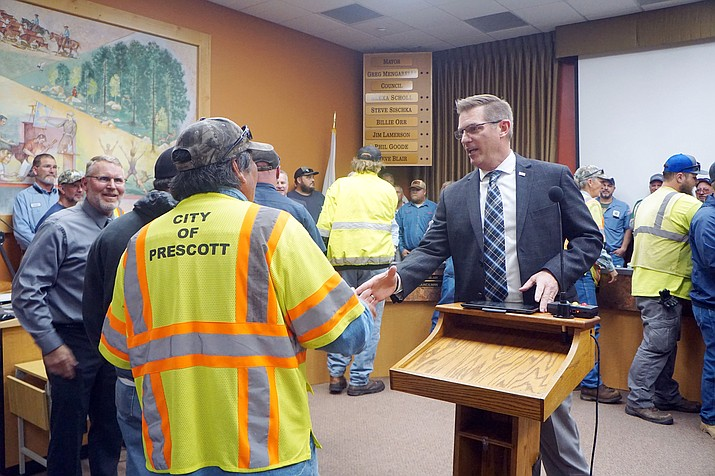 Prescott Mayor Greg Mengarelli thanks the dozens of Public Works and other city workers who helped with the emergency response during Prescott's Feb. 21 snowstorm. The city asked the workers to attend the Feb. 26 City Council meeting, and more than 40 gathered onstage during Mengarelli's remarks. (Cindy Barks/Courier)