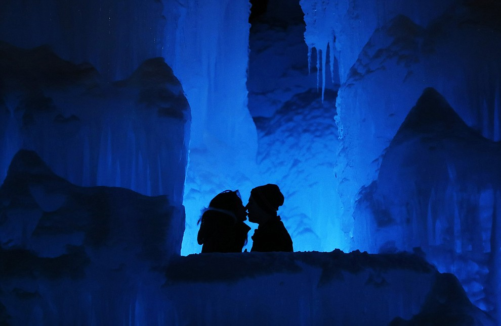 """In this Friday, Jan. 25, 2019 photo, a couple enjoy the Ice Castles in North Woodstock, N.H. """"It's a really popular date night spot,"""" said castle builder Matt Pasciuto. """"I can't tell you how many marriage proposals I've seen so far in the castle."""" (AP Photo/Robert F. Bukaty)."""