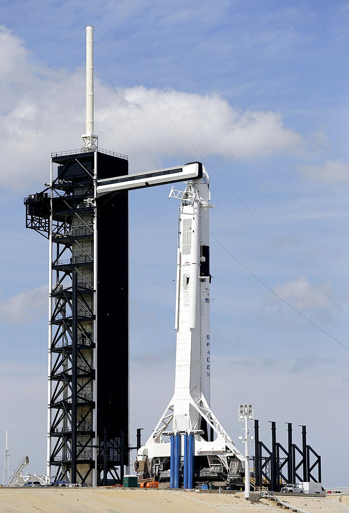 A Falcon 9 SpaceX rocket, ready for launch, sits on pad 39A at the Kennedy Space Center in Cape Canaveral, Fla., Friday, March 1, 2019. The Crew Dragon spacecraft unmanned test flight is scheduled for launch early Saturday morning. (AP Photo/Terry Renna)