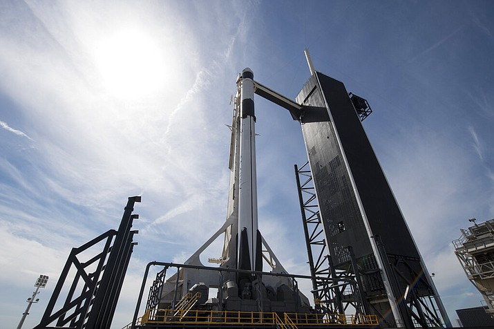 In this image released by NASA, a Falcon 9 SpaceX rocket, ready for launch, sits on pad 39A at the Kennedy Space Center in Cape Canaveral, Fla., Friday, March 1, 2019. The spacecraft's unmanned test flight with the Dragon capsule is scheduled for launch early Saturday morning. (Joel Kowsky/NASA via AP)