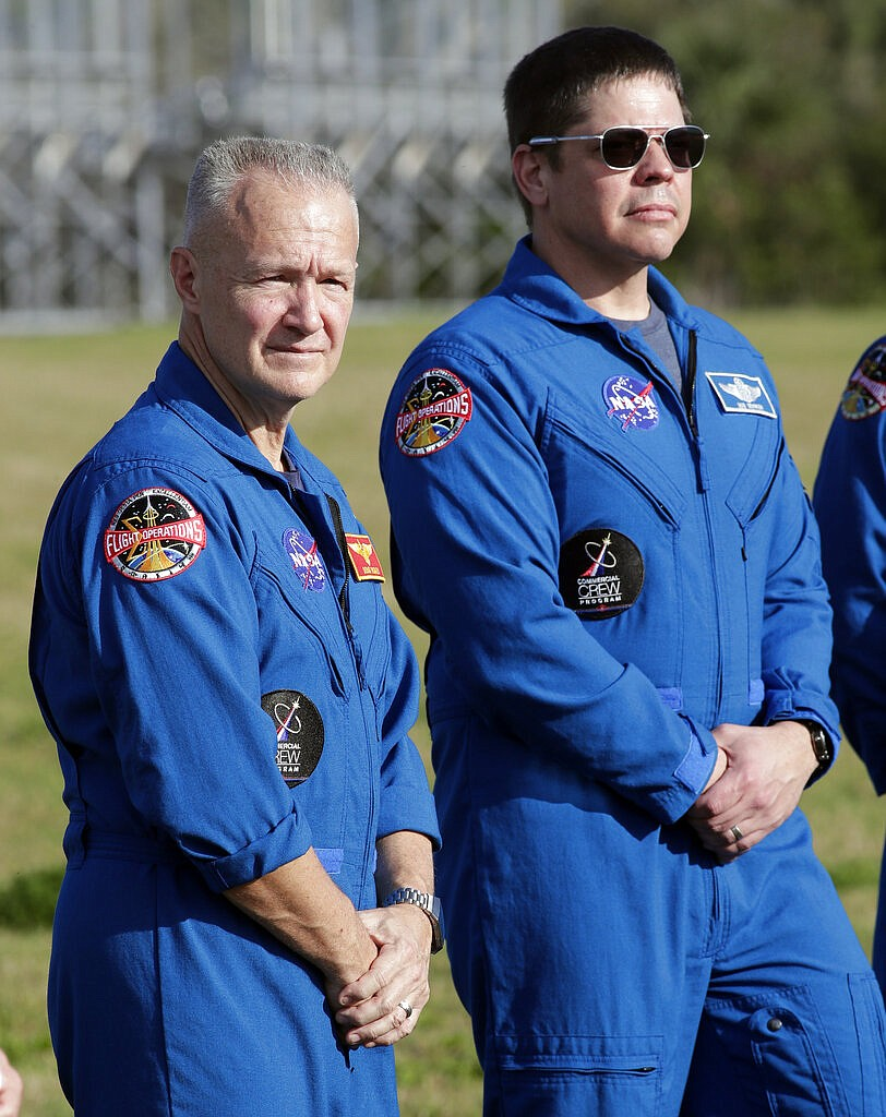 NASA astronauts Doug Hurley, left, and Bob Behnken attend a news conference before the Falcon 9 SpaceX Crew Demo-1 rocket launch at the Kennedy Space Center in Cape Canaveral, Fla., Friday, March 1, 2019. The astronauts are assigned to fly in the SpaceX Demo-2 flight test later this year. (AP Photo/John Raoux)