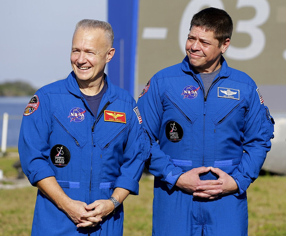 NASA astronauts Doug Hurley, left, and Bob Behnken attend a news conference before the Falcon 9 SpaceX Crew Demo-1 rocket launch at the Kennedy Space Center in Cape Canaveral, Fla., Friday, March 1, 2019. The astronauts are assigned to fly in the SpaceX Demo-2 flight test later this year. (AP Photo/Terry Renna)