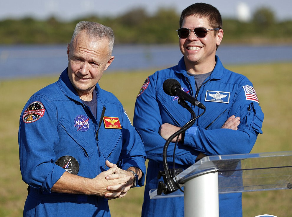 NASA astronauts Doug Hurley, left, and Bob Behnken answer questions during a news conference before the Falcon 9 SpaceX Crew Demo-1 rocket launch at the Kennedy Space Center in Cape Canaveral, Fla., Friday, March 1, 2019. The astronauts are assigned to fly in the SpaceX Demo-2 flight test later this year. (AP Photo/John Raoux)