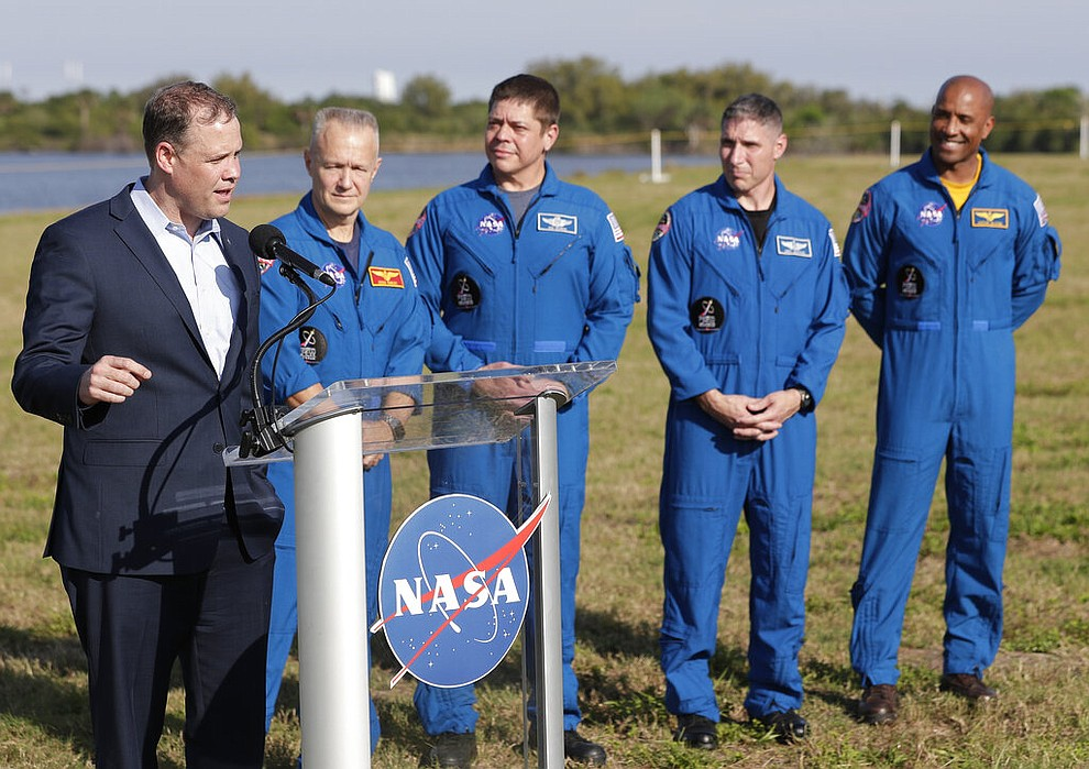 NASA Administrator Jim Bridenstine, left, speaks at a news conference with astronauts, from second left, Doug Hurley, Bob Behnken, Mike Hopkins and Victor Glover before Saturday's Falcon 9 SpaceX Crew Demo-1 rocket launch at the Kennedy Space Center in Cape Canaveral, Fla., Friday, March 1, 2019. (AP Photo/John Raoux)