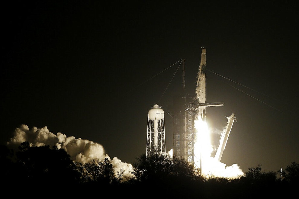 A SpaceX Falcon 9 rocket with the Demo 1 crew capsule lifts off from pad 39A, Saturday, March 2, 2019, in Cape Canaveral, Fla. (AP Photo/Terry Renna)