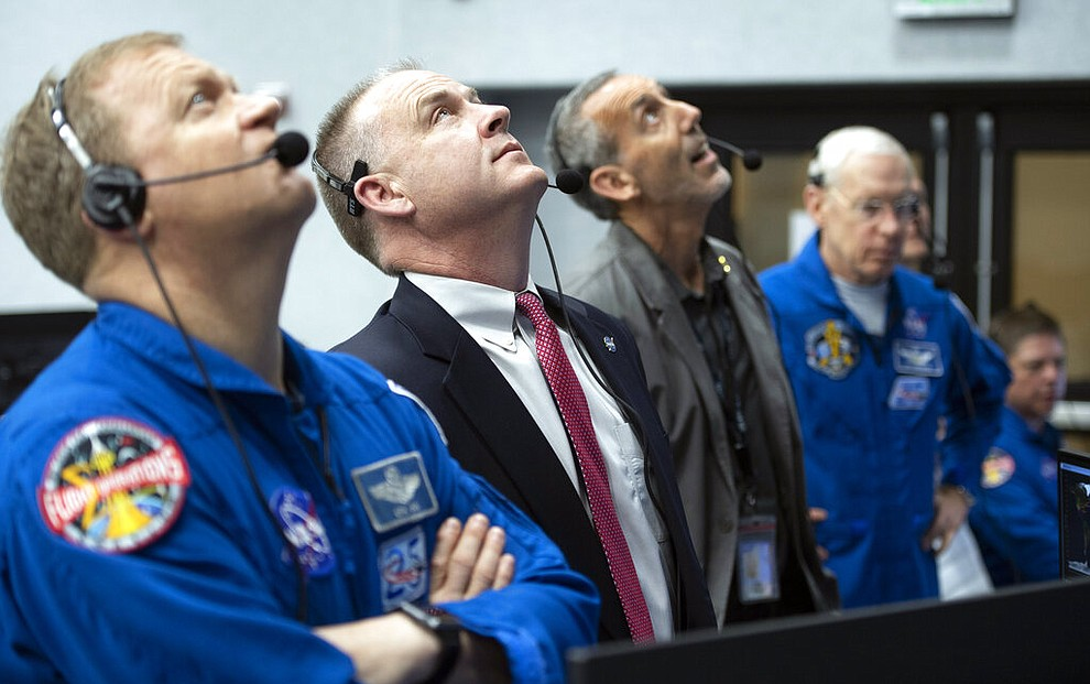 NASA astronaut Eric Boe, assistant to the chief of the astronaut office for commercial crew, left, and Norm Knight, deputy director of flight operations at NASA's Johnson Space Center watch the launch of a SpaceX Falcon 9 rocket carrying the company's Crew Dragon spacecraft on the Demo-1 mission from firing room four of the Launch Control Center, Saturday, March 2, 2019 at the Kennedy Space Center in Florida. America's newest capsule for astronauts rocketed Saturday toward the International Space Station on a high-stakes test flight by SpaceX. (NASA/Joel Kowsky)