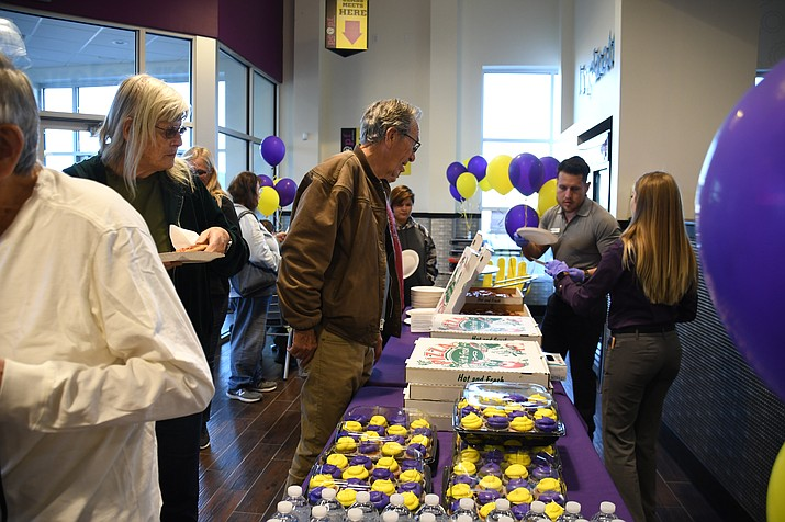 Community members took the time to stop at the Planet Fitness grand opening to learn more on what the facility, 3915 Stockton Hill Rd., has to offer. The event had food and raffles for guests. (Photo by Vanessa Espinoza/Daily Miner)