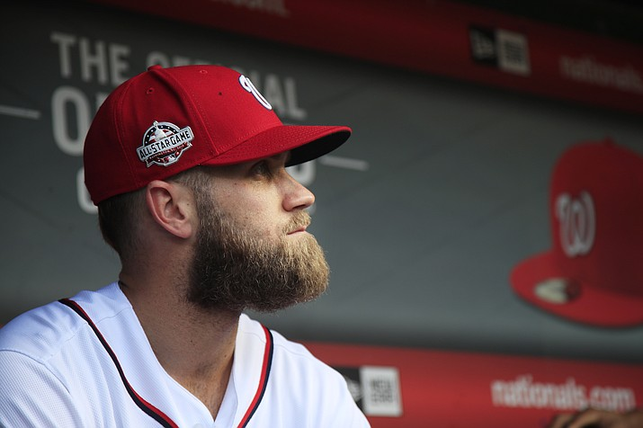 Washington Nationals' Bryce Harper, looks at the field from their dugout before the start of the Nationals last home game of the season Sept. 26, 2018, against the Miami Marlins in Washington. (Manuel Balce Ceneta/AP, File)