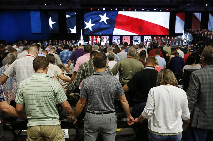 People pray for America at the 2018 Annual Meeting of the Southern Baptist Convention June 12, 2018, at the Kay Bailey Hutchison Dallas Convention Center in Dallas. The SBC confronted a sex-abuse crisis in the form of an investigation by the Houston Chronicle and San Antonio Express-News. The newspapers reported that hundreds of Southern Baptist clergy and staff had been accused of sexual misconduct over the past 20 years. (Vernon Bryant/The Dallas Morning News via AP, File)