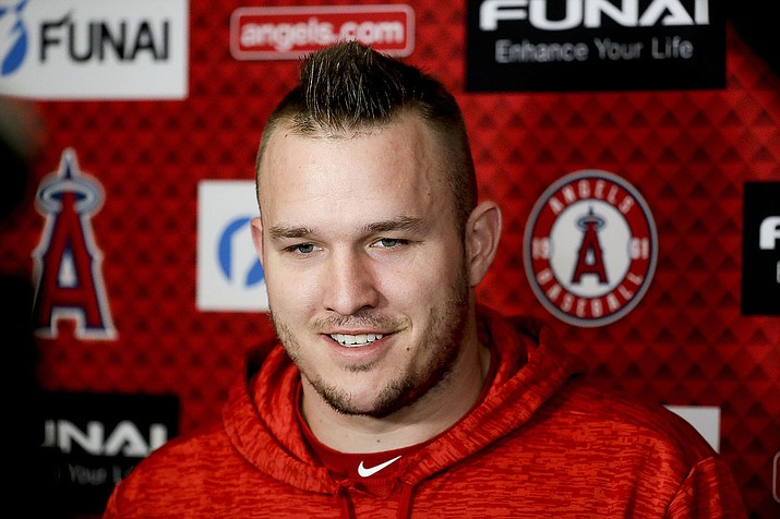Los Angeles Angels' Mike Trout says he hasn't considered how Bryce Harper's deal will set the stage for his own negotiations. (Chris Carlson/AP, file)