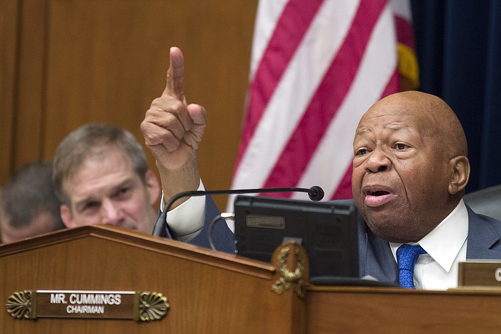 In this Wednesday, Feb. 27, 2019 file photo, House Oversight and Reform Committee Chair Elijah Cummings, D-Md., right, speaks as he gives closing remarks with Rep. Jim Jordan, R-Ohio, the ranking member, at left, as the hearing for Michael Cohen, President Donald Trump's former lawyer, at the House Oversight and Reform Committee concludes, on Capitol Hill, in Washington. Cummings, said afterward that he wanted to call in several people mentioned repeatedly by Cohen. (Alex Brandon/AP, file)