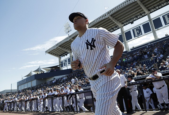 New York Yankees' Aaron Judge runs onto the field before a spring training baseball game Feb. 25, 2019, in Tampa, Fla. Judge hit two homers in a 7-1 win over the Detroit Tigers on Sunday, March 3, 2019.(Lynne Sladky/AP, file)