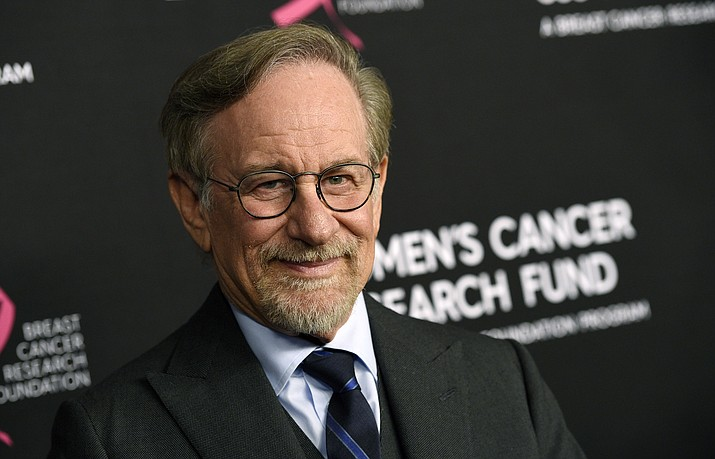 "In this Thursday, Feb. 28, 2019, file photo, filmmaker Steven Spielberg poses at the 2019 ""An Unforgettable Evening"" benefiting the Women's Cancer Research Fund, at the Beverly Wilshire Hotel, in Beverly Hills, Calif. Reports that Spielberg intends to support rule changes that could block Netflix from Oscars-eligibility have provoked a heated and unwieldy online debate. (Chris Pizzello/Invision/AP, File)"