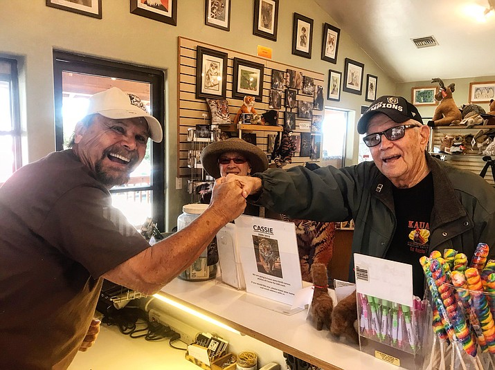 """Lew Rees of Courier Cares shows his gratitude to Chuck and Terry Baldok, who donated $150 to Heritage Park Zoological Sanctuary during the """"Lew Loves the Zoo"""" event Monday, March 4, 2019. Before moving to Prescott, the Baldoks were members of the San Diego Zoo and they love animals. During the """"Lew Loves the Zoo"""" fundraising event, Rees is scheduled to complete various tasks around the zoo, and on Monday, he manned the gift shop. The fundraiser """"Lew Loves the Zoo"""" takes place March 3-7, raising $9,514.71 on day two Monday for a grand total of $18,071.84 so far. On Tuesday, he will be a """"Keeper for the Day,"""" shadowing a zookeeper and learning what they do to care for animals. (George Johnston/Courier)"""