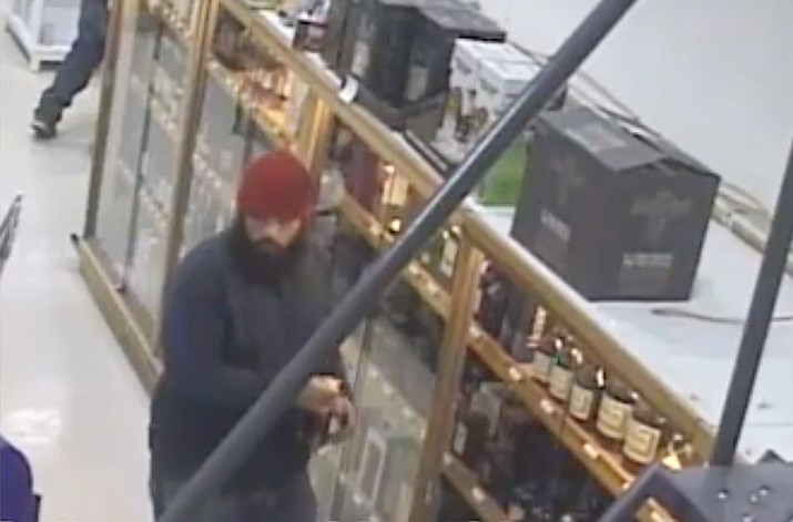 Chris Gasbarro's Fine Wine and Spirits in Seekonk, Massachusetts says this suspect stole a $4,000 bottle of the Remy Martin Louis XIII cognac from its store last week. (Seekonk Police Department)