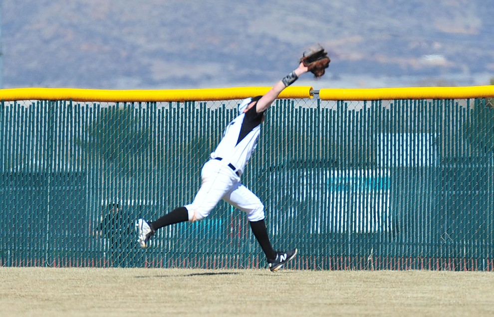 Bradshaw Mountain's Jordan Massis gets the catch in deep center field as the Bears host the Flagstaff Eagles Tuesday, March 5, 2019 in Prescott Valley. (Les Stukenberg/Courier)