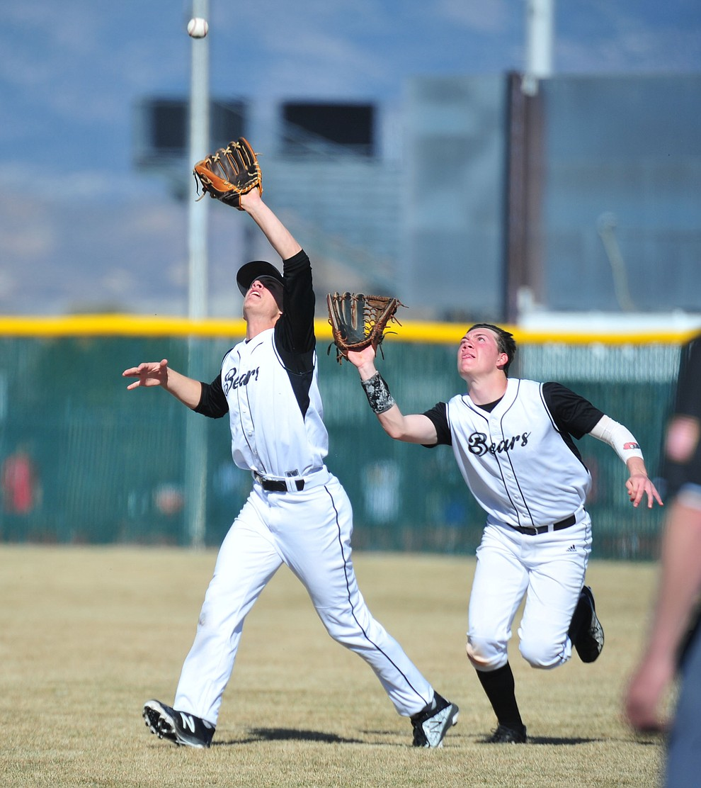 Bradshaw Mountain's Josh Grant and Jordan Massis go for a shallow fly ball as the Bears host the Flagstaff Eagles Tuesday, March 5, 2019 in Prescott Valley. (Les Stukenberg/Courier)