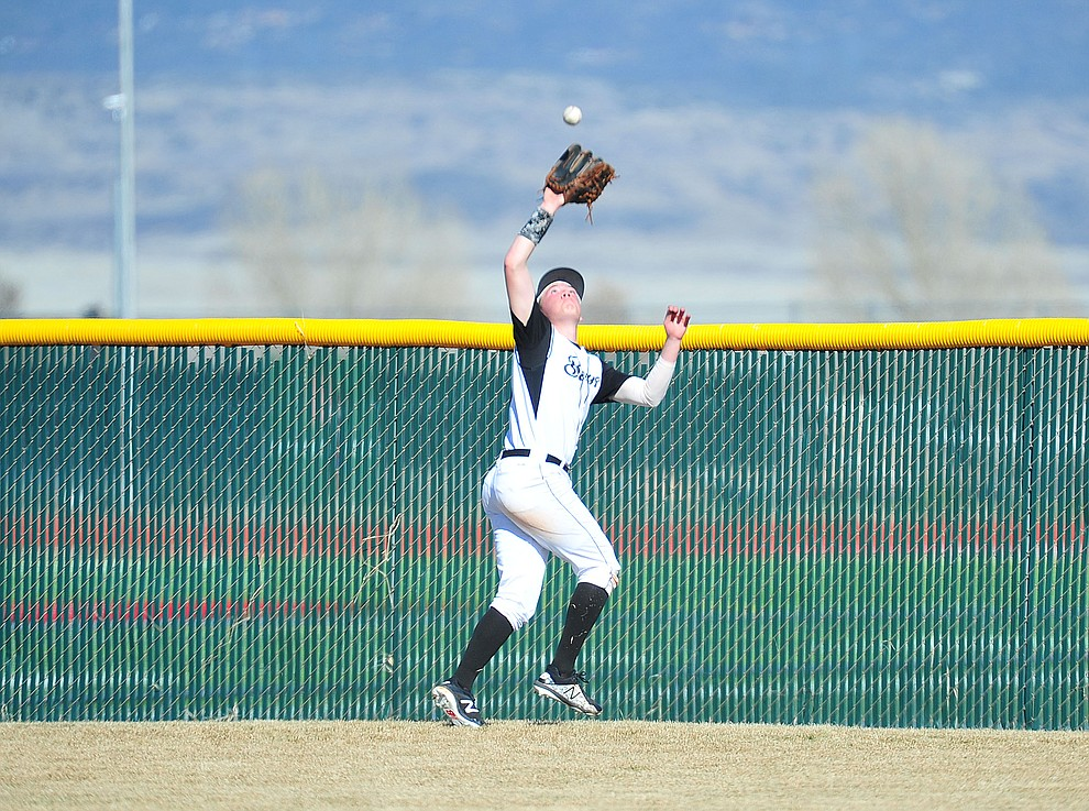 Bradshaw Mountain's Jordan Massis has his eye on the ball in deep center field as the Bears host the Flagstaff Eagles Tuesday, March 5, 2019 in Prescott Valley. (Les Stukenberg/Courier)