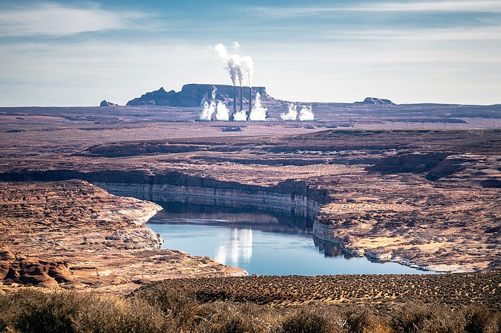 Navajo Generating Station owners said they plan to move forward with decommissioning the coal-fired power plant near Page, Arizona. NGS provides almost 1,000 jobs between the plant and the mine that supplies it. (Photo/Adobe stock)