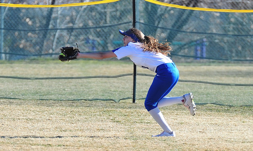 Prescott's Dana Seevey goes for a catch as the Badgers host the Mingus Marauders Tuesday, March 5, 2019 in Prescott. (Les Stukenberg/Courier)