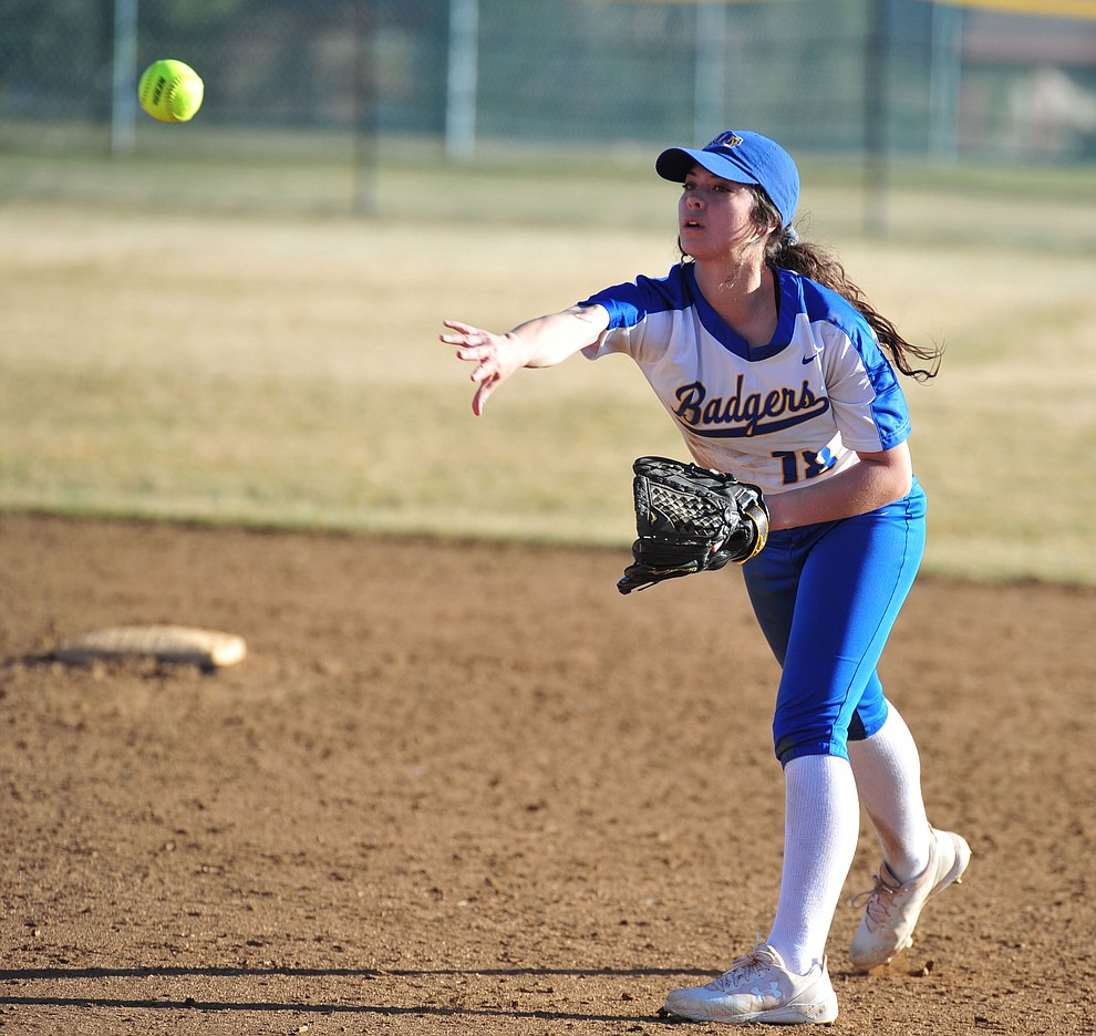 Prescott's Tessa Eppele slides maes the throw from second as the Badgers host the Mingus Marauders Tuesday, March 5, 2019 in Prescott. (Les Stukenberg/Courier)