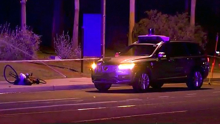 This March 19, 2018 still image taken from video shows the scene of a fatal accident involving a self driving Uber car on the street in Tempe, Ariz. (ABC-15.com via AP)