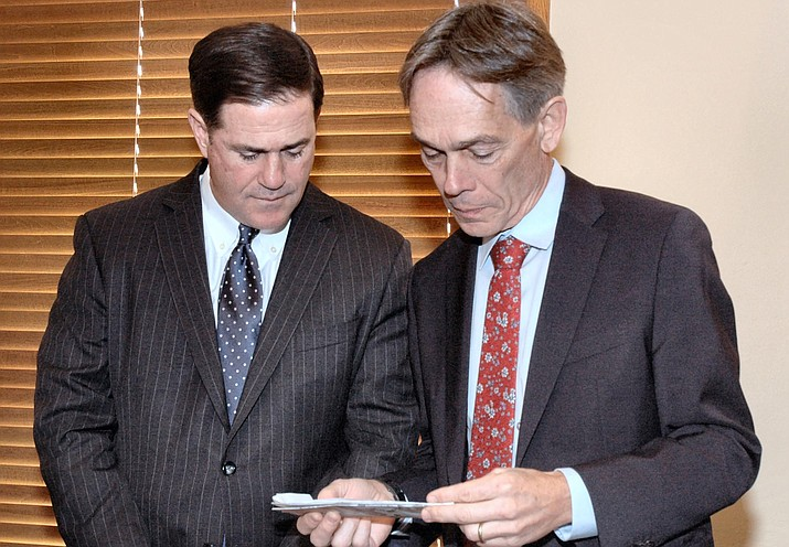 Chief Justice Scott Bales, right, in December with Gov. Doug Ducey. It will now be up to Ducey to choose a replacement. (Capitol Media Services file photo by Howard Fischer)
