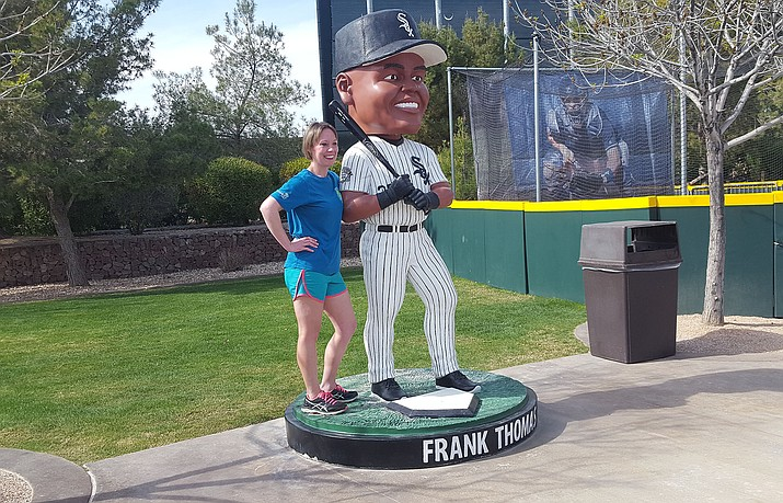 "A fan has her picture taken with a giant Frank Thomas bobblehead at Camelback Ranch on Monday, March 4, 2019, in Glendale. I am pretty sure the ""Big Hurt"" was never this thin when he was playing. (Doug Graham/Courier)"