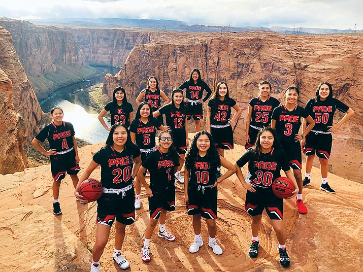 The Page High School Lady Sand Devils pose for a group picture near Lake Powell in Page, Arizona. (Photo by Ryan Whitehorse)