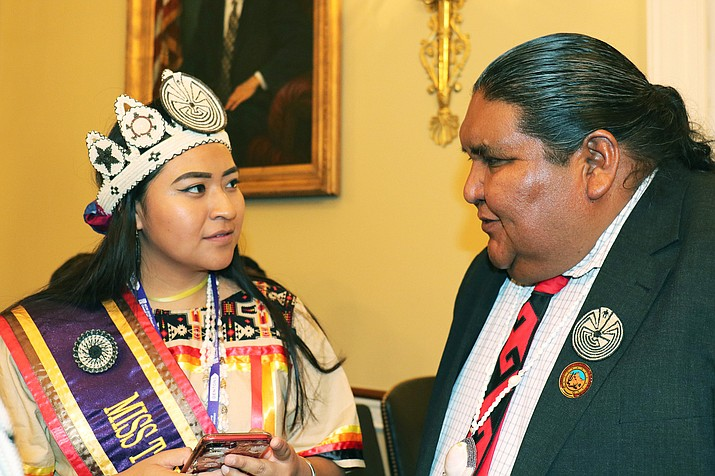 Tohono O'odham Vice Chairman Verlon Jose talks to Miss Tohono O'odham 2019 Maria Keteri Pablo at a House Natural Resources subcommittee hearing on the impact climate change has had on tribal areas. (Photo by Keerthi Vedantam/Cronkite News)