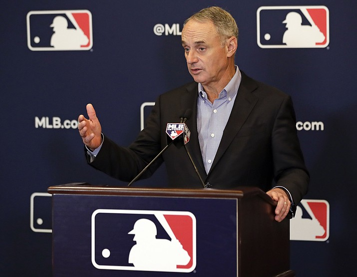 This Feb. 8, 2019, file photo shows Rob Manfred, commissioner of Major League Baseball, speaking during a news conference at owners meetings in Orlando, Fla. Major League Baseball and the players' union are near an agreement to expand active rosters by one to 26 starting in 2020 as part of a deal that would include a commitment to discuss larger economic issues after opening day. (John Raoux/AP, file)
