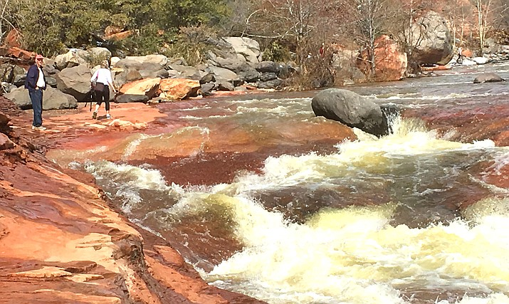 The Arizona State Parks Department will remove the large rock wedged into the chute used by swimmers at the popular Slide Rock State Park, once they have figured out how to move it. VVN/Vyto Starinskas