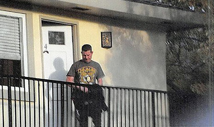 The Drug Enforcement Administration says this man, 49-year-old Alex Taylor, was arrested Saturday after an investigation into reports he was driving a Volkswagen Jetta with police lights and making unauthorized traffic stops. Taylor is seen in this U.S. Department of Justice photo wearing a gold DEA-style badge around his neck at a home in San Jose, California on Friday, March 1, 2019. (U.S. Department of Justice)