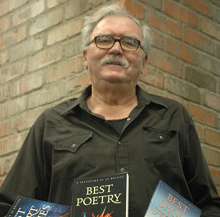 Professional Writers of Prescott President Pat Fogarty with the first three books the group has published: two collections of short stories and one collection of poetry. (Jason Wheeler/Courier)